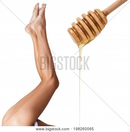 Female legs depilation by honey or sugar pasta. Sugar hair removal concept.