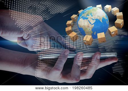 Hands using mobile phone on white background against glowing world map on black background