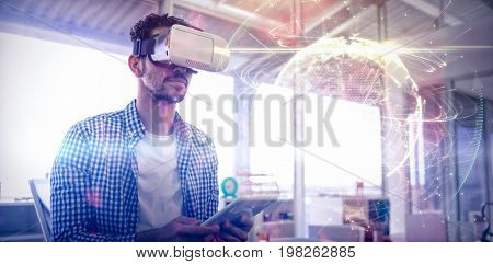 Global technology background in green against executive using virtual reality headset and digital tablet