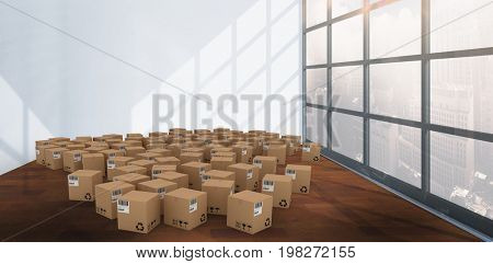 Group of digital composite cardboard boxes against interior of empty room