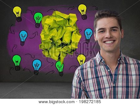 Digital composite of Man standing next to light bulbs with crumpled paper ball