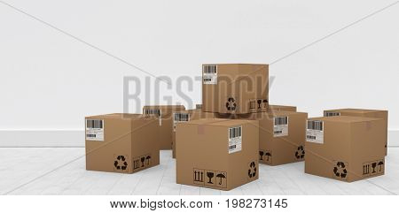 Group of graphic cardboard boxes against gray flooring and wall