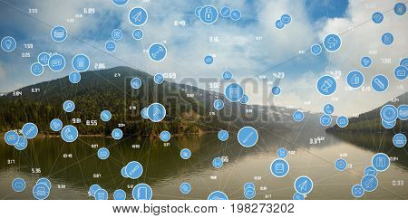 Full frame shot of blue computer icons against mountain range reflecting on river against sky