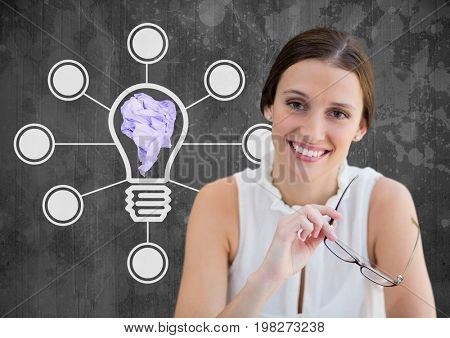 Digital composite of Woman standing next to light bulb connections with crumpled paper ball