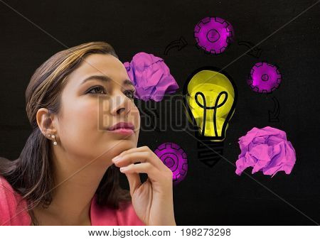 Digital composite of Woman thinking next to light bulb with crumpled paper balls
