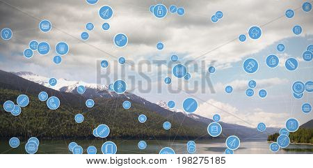 Full frame shot of circular computer icons against river and snowcapped mountains against cloudy sky