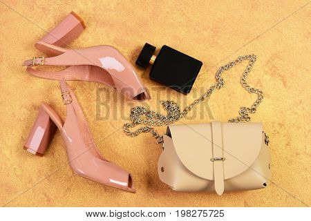 Fashion And Beauty Concept. Pair Of Pink Shoes, Beige Handbag