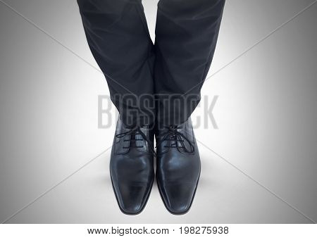 Digital composite of Mans legs and feet in black suit and shoes