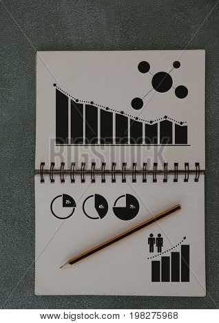 Digital composite of Business Charts and statistics drawn on notepad