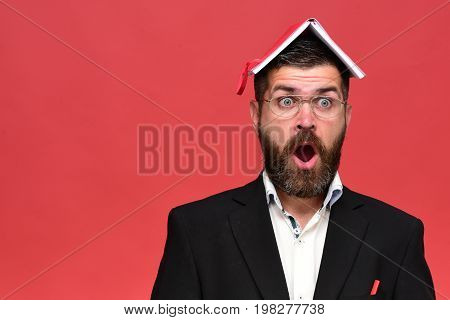 Businessman With Surprised Face And Glasses Isolated On Red Background
