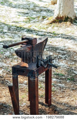 Worn Iron Anvil And Hammer