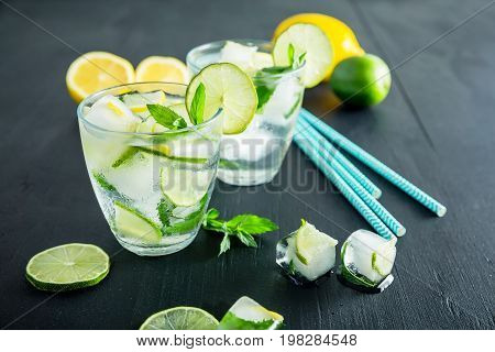 Refreshing citrus cocktail with crushed ice and lame with lemon
