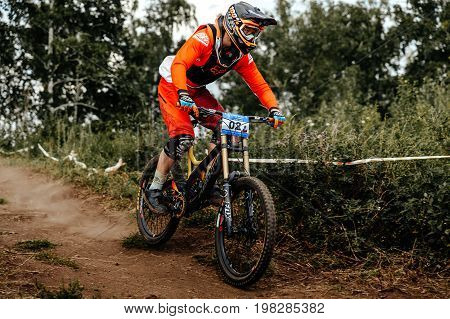 Magnitogorsk Russia - July 22 2017: man rider on bike mountain biking earthen trail during National championship downhill