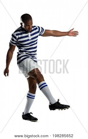 Full length of male rugby player playing against white background