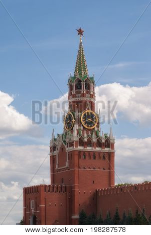 Kremlin Clock Chimes Close-up Against A Blue Cloudy Sky. Moscow