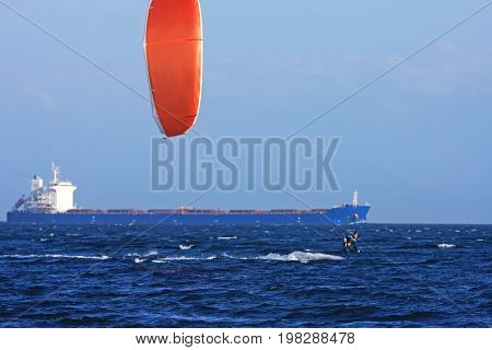 kitesurfer and container ship off Vancouver Island