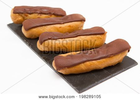 Chocolate eclairs A selection of homemade cream filled chocolate eclairs