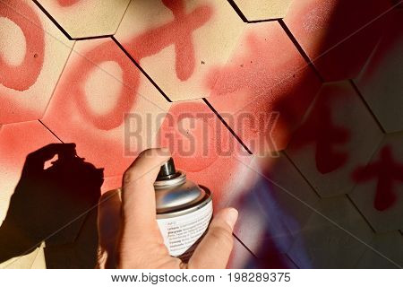 wall with graffiti painting, spraying, drawing, street art and graffiti culture topics