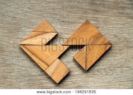 Wooden tangram puzzle in separate heart shape background (Concept for love complete marriage divorce broken relationship)