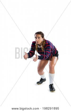 Female rugby player in catching position against white background