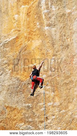 The rock-climber during rock conquest. Active sport concept.