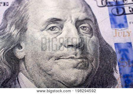 Close Up Of Benjamin Franklin Face On Us Dollar