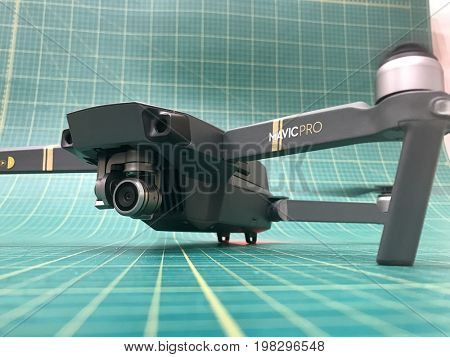 LONDON - AUGUST 2, 2017: DJI Mavic Pro gimbal stabilised 4K video and photo camera drone ready for takeoff with rotating motors.