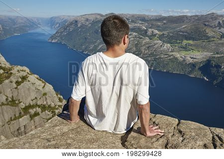 Norwegian fjord landscape. Hiker. Preikestolen landmark. Norway adventure tourism