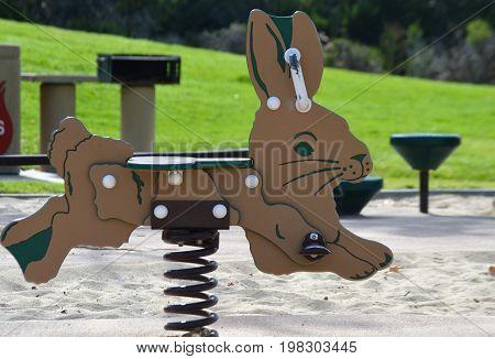 horizontal image of rabbit sit on playgoer toy