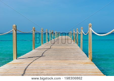 Wooden bridge over the sea. Travel and Vacation. Freedom Concept