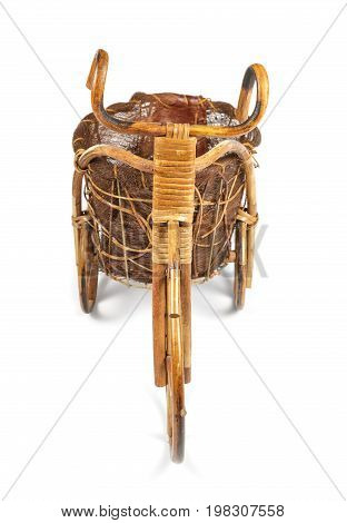 Flower stand in the form of a bicycle made from rattan. Front view