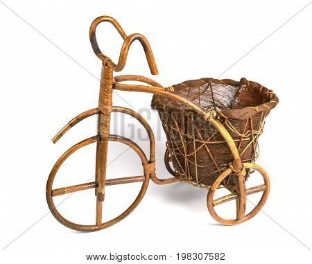 Flower stand in the form of a bicycle made from rattan. Left view
