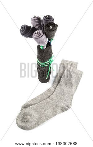 Gift to a man in the form of a bouquet of socks on a white background