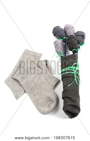 Bouquet of flowers made from socks as a gift on a white background