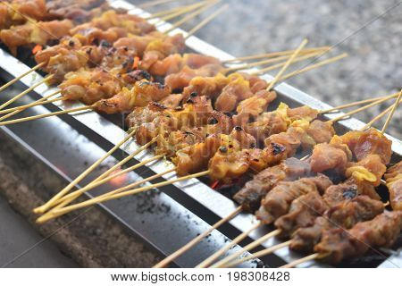 Roasting meat, chicken and mutton satay on the charcoal.