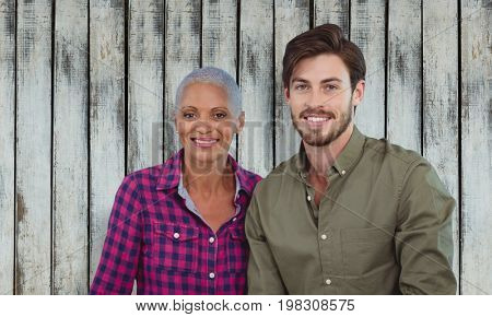Portrait of a young man and a woman posing against wood background
