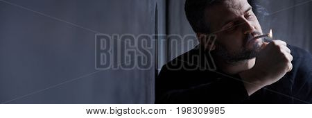 Depressed Man Smoking Cigarette