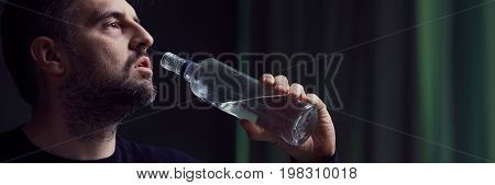Man Drinking Alcohol From Bottle
