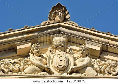 Baku, Azerbaijan - July 23, 2017.  Sculptures of women on facade of architectural building in downtown Baku.