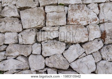 rustic ancient handcraft tile stack stone wall as background in Italy.