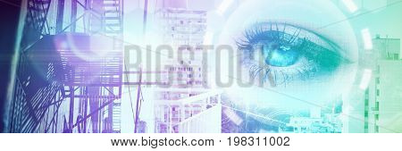 Close up of female blue eyes against white buildings by sea