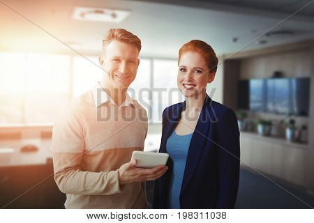 Smiling business people using a digital tablet  against tables in office cafeteria Smiling business people using a digital tablet against white background