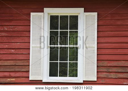 rustic image of weathered red boards and white window