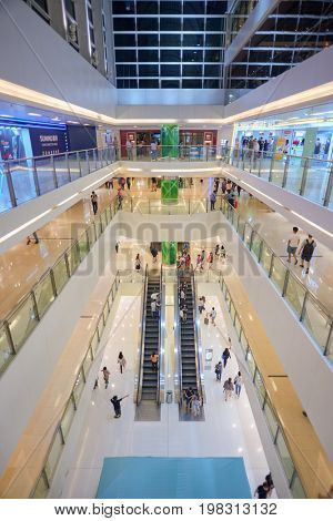 HONG KONG - MAY 17, 2015: inside New Town Plaza shopping mall. New Town Plaza is a shopping mall in the town centre of Sha Tin in Hong Kong.