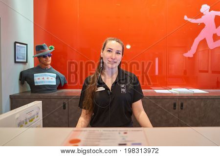 CHICAGO, IL, - CIRCA MARCH, 2016: friendly receptionist at Chicago Getaway Hostel front desk.