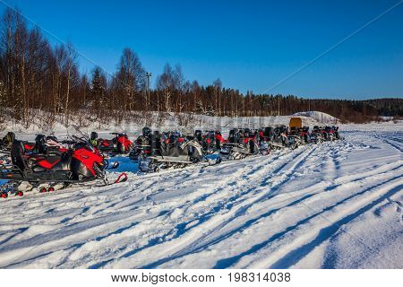 Travel to Lapland. The first trip on snowmobiles in special suits. The concept of active and extreme tourism