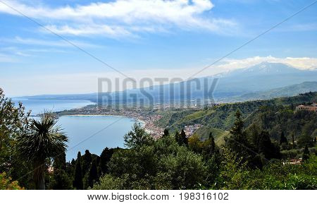 The bay of Giardini-Naxos with the Etna in the background viewed from Taormina Sicily Italy.