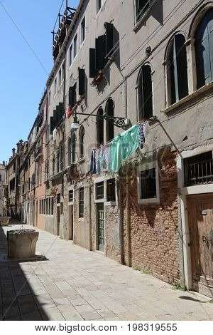 Street In Venice Called Calla With The Well And The Clothes Hang
