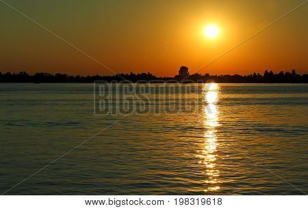 Yellow Sun At The Sunset With Reflections On The Water Of The Ad