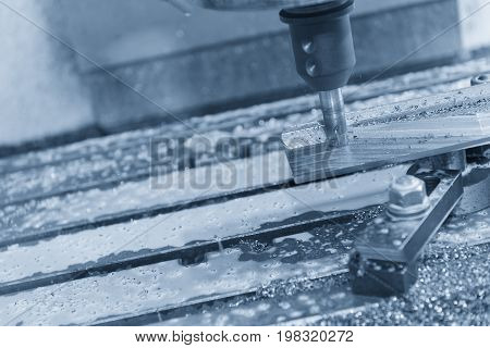 The CNC milling machine cutting the sample part with the ball endmill in light blue scene.The hi-precision mechanical part.